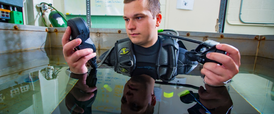 Scuba diver in a submersion tank performing research in Center for Research and Education in Special Environments.