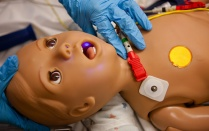 Face of a child dummy in the simulation center.
