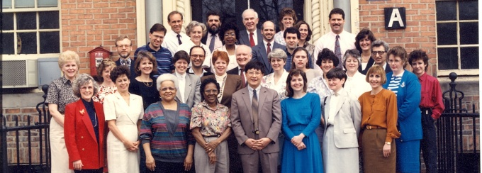 Faculty and staff from the department of Social and Preventive Medicine gather together on the steps of 2211 Main Street, approximately 1989.