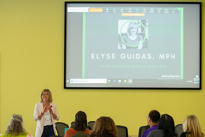 Elyse Guidas, executive director of Farm Express, gives the keynote address at the first-ever mobile produce market summit, held last spring at UB. Photo: Douglas Levere.