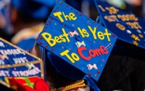 "Photo of a graduation cap that reads ""Best is Yet to Come.""."