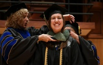 Erin McDowell smiles proudly as she receives her hood during the 2017 ceremony.