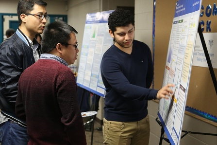 left to right, Biostatistics Assistant Professor Jiwei Zhao, PhD, and Biostatistics Assistant Professor Guan Yu, PhD, discuss student Jonathan Hercules's research poster during the Undergraduate Winter Institute for Biostatistics. Photo: Caryn Sobieski-VanDelinder.