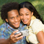 Smiling African American couple taking a selfie.