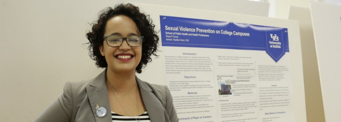 Sharyl Evans, an MPH student in community health and health behavior, presenting her poster at Perry Poster Day.