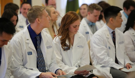 Students in their white coats.